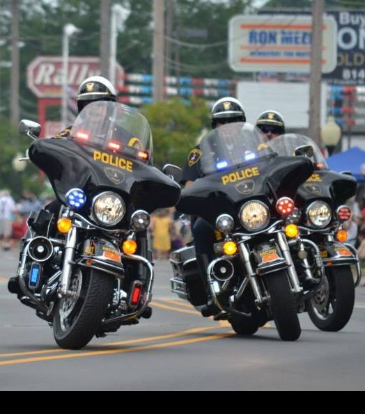 Officers in formation on motorcycles